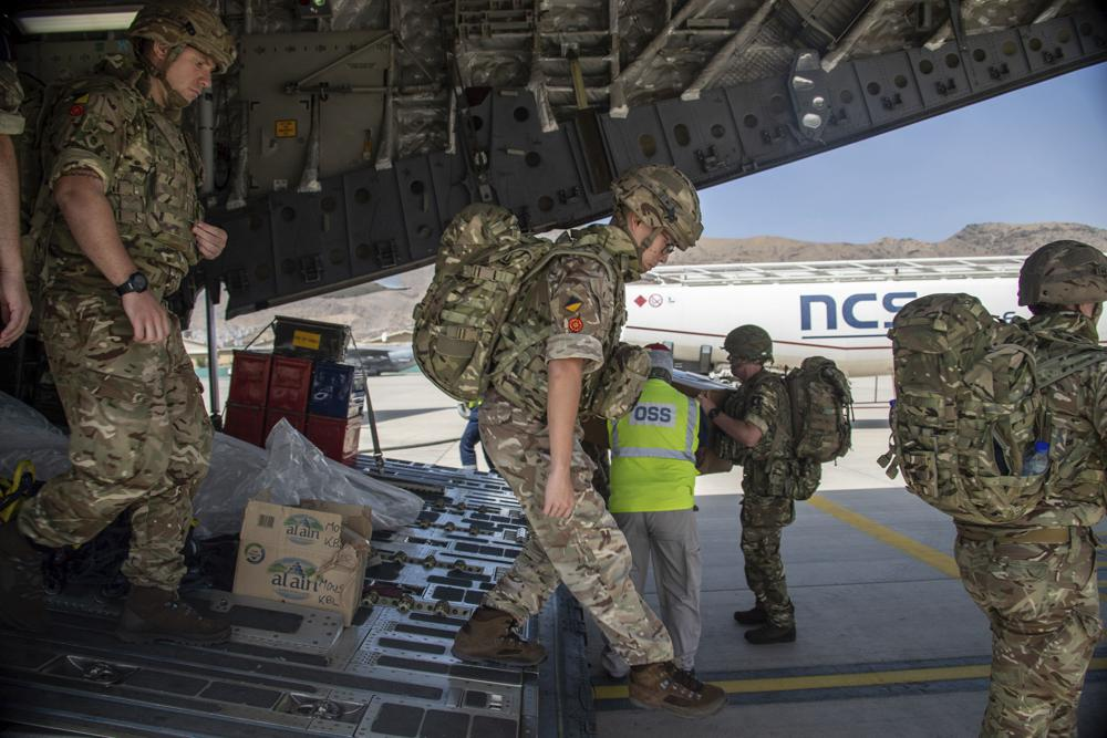 In this photo provided by the Ministry of Defence on Sunday, Aug. 15, 2021, members of the 16 Air Assault Brigade arrive in Kabul as part of a 600-strong UK-force sent to assist with Operation PITTING to rescue British nationals in Afghanistan amidst the worsening security situation there. (Leading Hand Ben Shread/Ministry of Defence via AP)