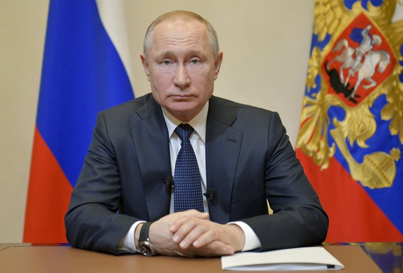 Citing virus, Putin delays vote that would extend his rule