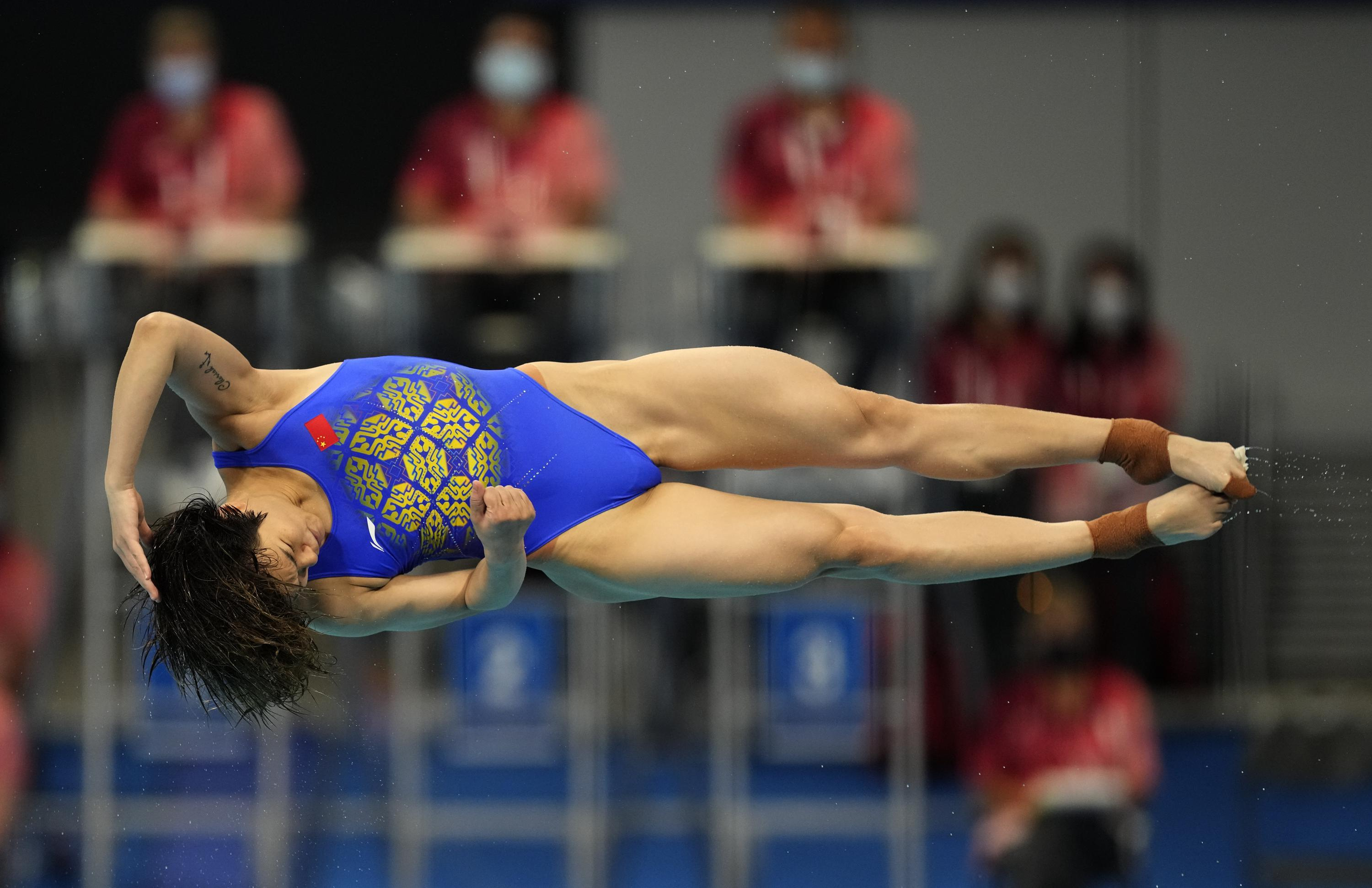 Shi , Wang lead the way again in Olympic springboard diving