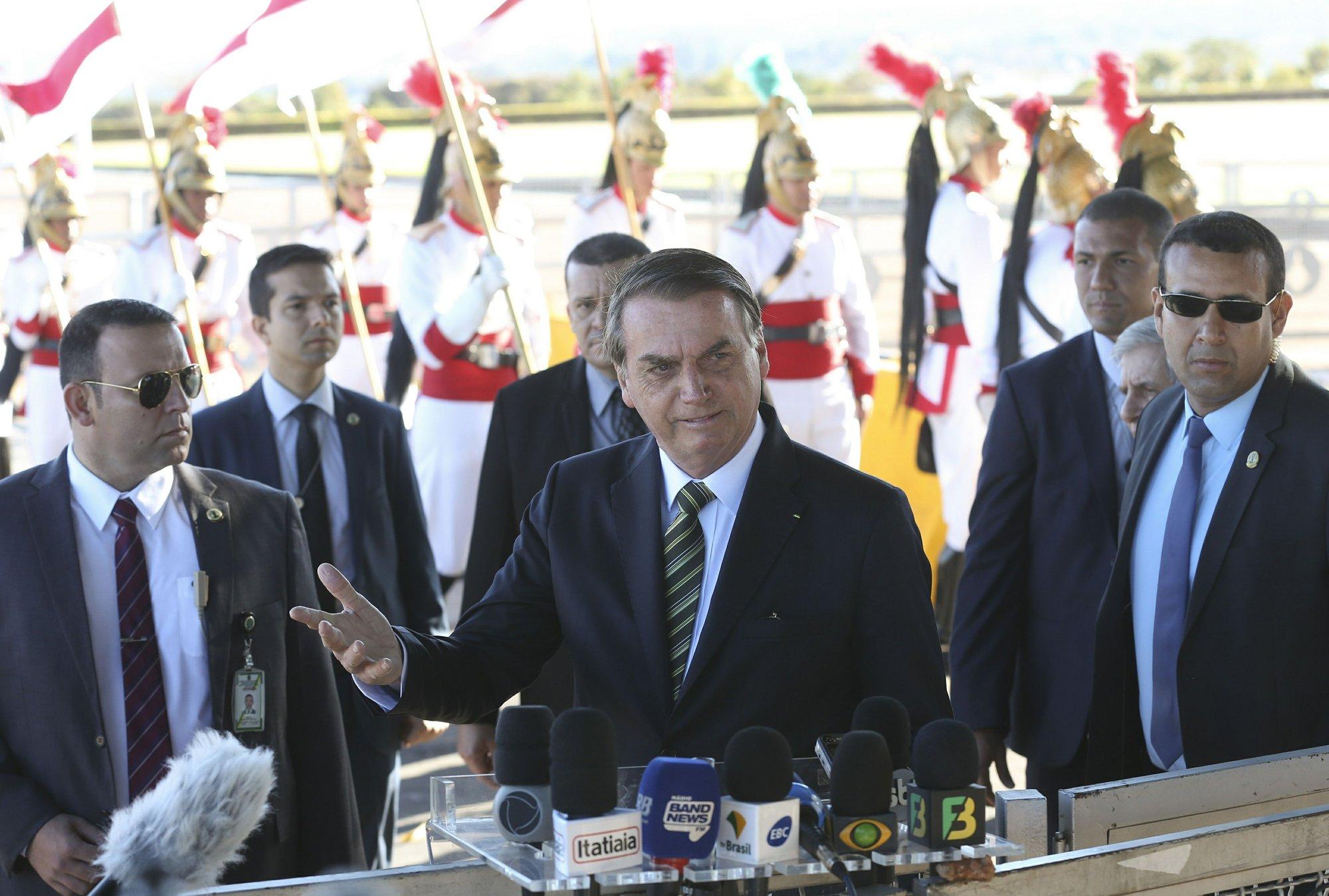 The Latest: Brazil leader criticizes indigenous reserves