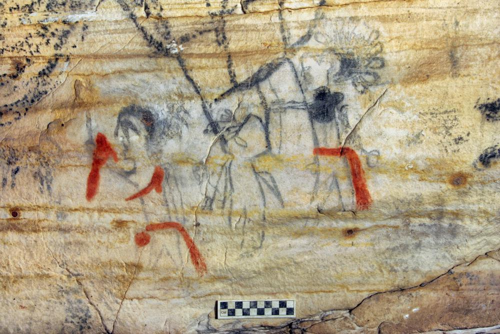 """This undated photo provided by Alan Cressler shows a Missouri cave featuring artwork from the Osage Nation dating more than 1,000 years was sold at auction on Tuesday, Sept. 14, 2021. The art inside """"Picture Cave"""" shows humans, animals and mythical creatures. Experts who have studied the cave were concerned about the auction, but the director of the auction company said protections are in place to prohibit the new buyer from exploiting the cave, including a Missouri law that makes doing so a crime. (Alan Cressler via AP)"""