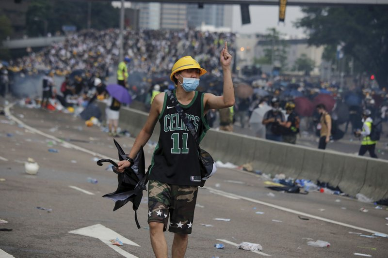 A protester gestures after clashes with riot police during a massive demonstration outside the Legislative Council in Hong Kong, June 12, 2019. (AP Photo/Kin Cheung)