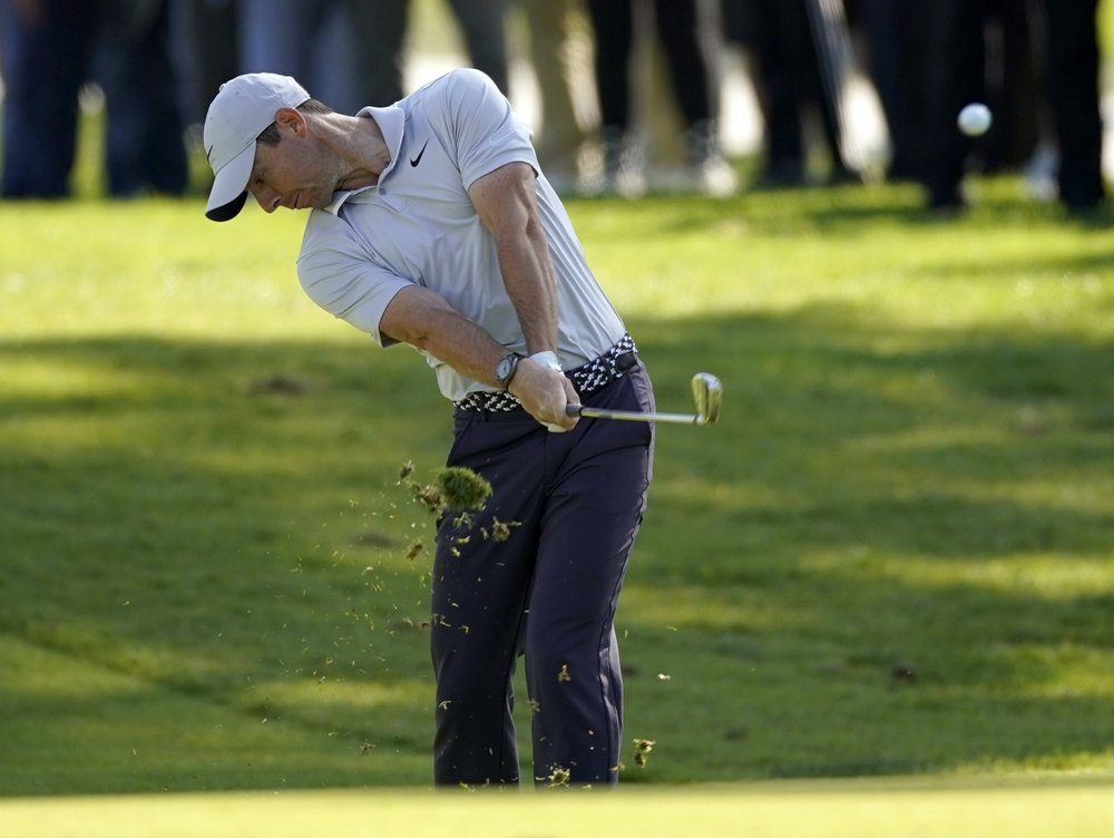 McIlroy, Scott, Kuchar share lead at Riviera; Woods falters