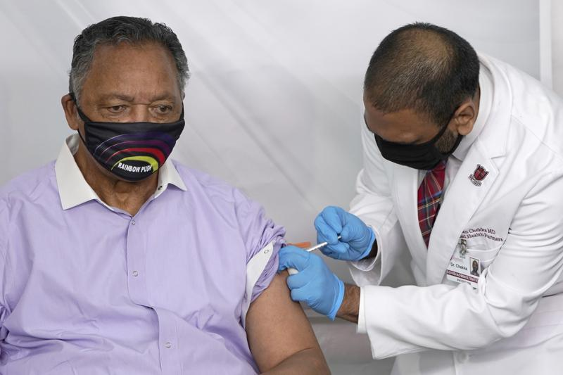 FILE - In this Friday, Jan. 8, 2021 file photo, Rev. Jesse Jackson receives the Pfizer's BioNTech COVID-19 vaccine from Dr. Kiran Chekka, Covid Administration Physician at the Roseland Community Hospital in Chicago. The Rev. Jesse Jackson and his wife, Jacqueline, have been hospitalized after testing positive for COVID-19 according to a statement Saturday, Aug. 21, 2021. He is vaccinated against the virus and publicly received his first dose in January. According to a statement released Saturday evening, the Jacksons are being treated at Northwestern Memorial Hospital in Chicago. He is 79 years old. Jacqueline Jackson is 77.  (AP Photo/Charles Rex Arbogast, File)