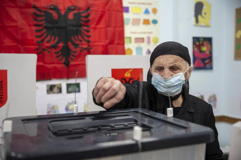 Albania exit polls shows ruling Socialist Party in tight race with the opposition Democratic Party