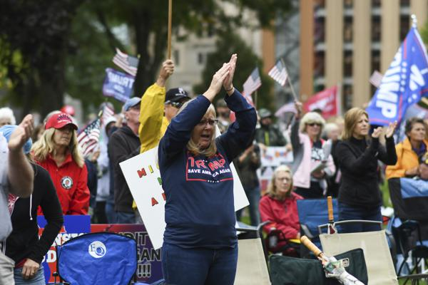 """Rally-goers protest at the Michigan State Capitol Tuesday, Oct. 12, 2021, in Lansing, Mich. The event, organized by a group called Election Integrity Fund and Force, is demanding a """"forensic audit"""" of the state's 2020 presidential election results. (Matthew Dae Smith/Lansing State Journal via AP)"""