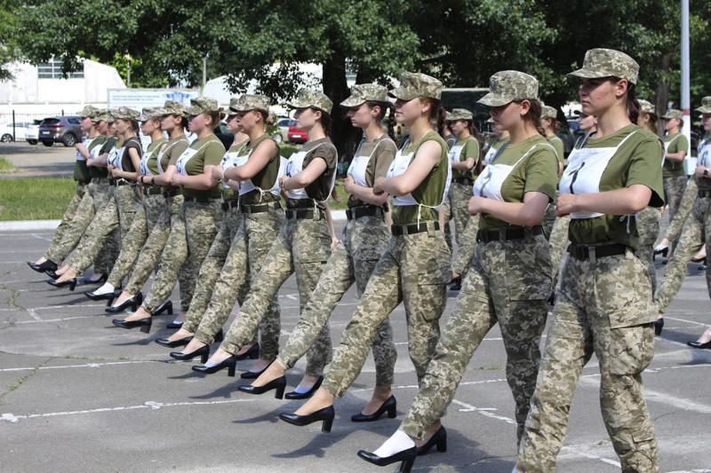 """In this photo taken and released by the Ukrainian Defense ministry press-service on July 2, 2021, Ukrainian female soldiers wear heels while taking part in the the military parade rehearsal in Kyiv, Ukraine. Ukraine's defense minister is under pressure from members of the government over the decision to have female military cadets wear mid-heeled pumps in a parade. A joint statement from three Cabinet members, including Minister of Veterans Affairs Yulia Laputina, said """"the purpose of any military parade is to demonstrate the military ability of the army. (Ukrainian Defense Ministry Press Office via AP)"""
