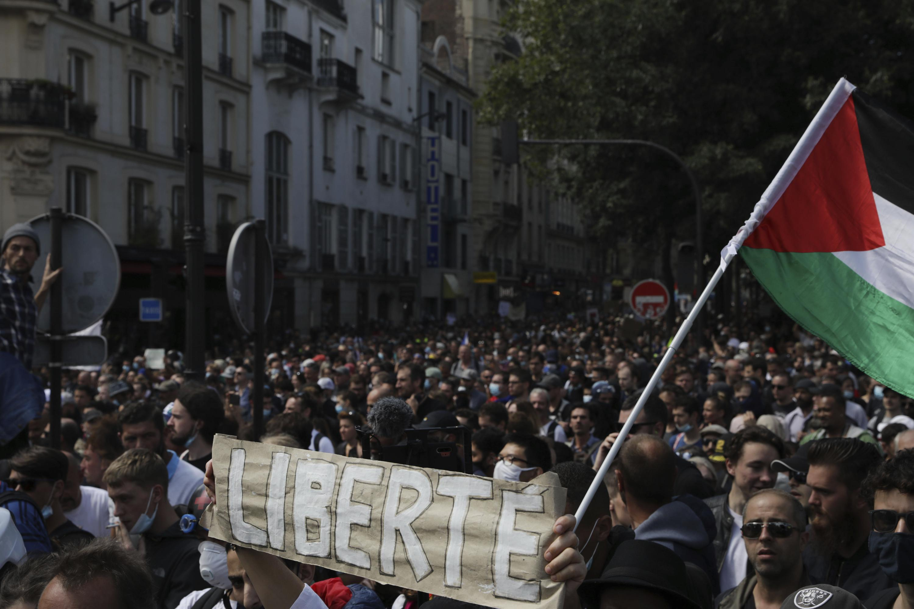 French police clash with anti-virus pass protesters in Paris - Associated Press