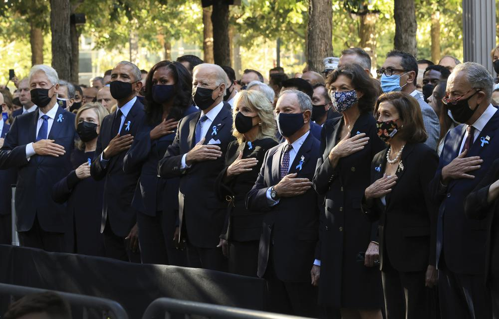From left, former President Bill Clinton, former First Lady Hillary Clinton, former President Barack Obama, Michelle Obama, President Joe Biden, first lady Jill Biden, former New York City Mayor Michael Bloomberg, Bloomberg's partner Diana Taylor, Speaker of the House Nancy Pelosi, D-Calif., and Senate Minority Leader Charles Schumer, D-N.Y., stand for the national anthem during the annual 9/11 Commemoration Ceremony at the National 9/11 Memorial and Museum on Saturday, Sept. 11, 2021 in New York. (Chip Somodevilla/Pool Photo via AP)