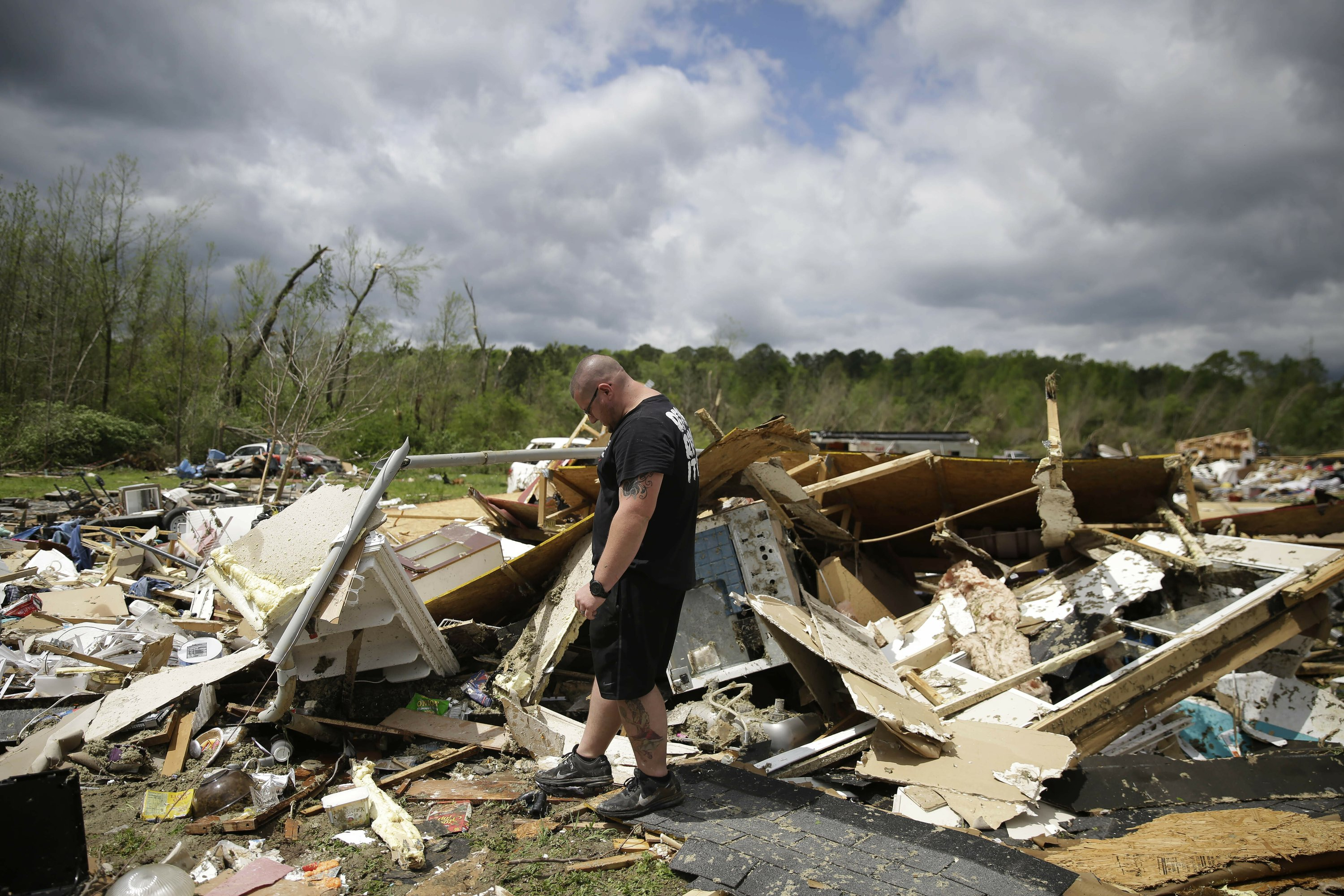 Storm tears through South amid pandemic; at least 30 dead