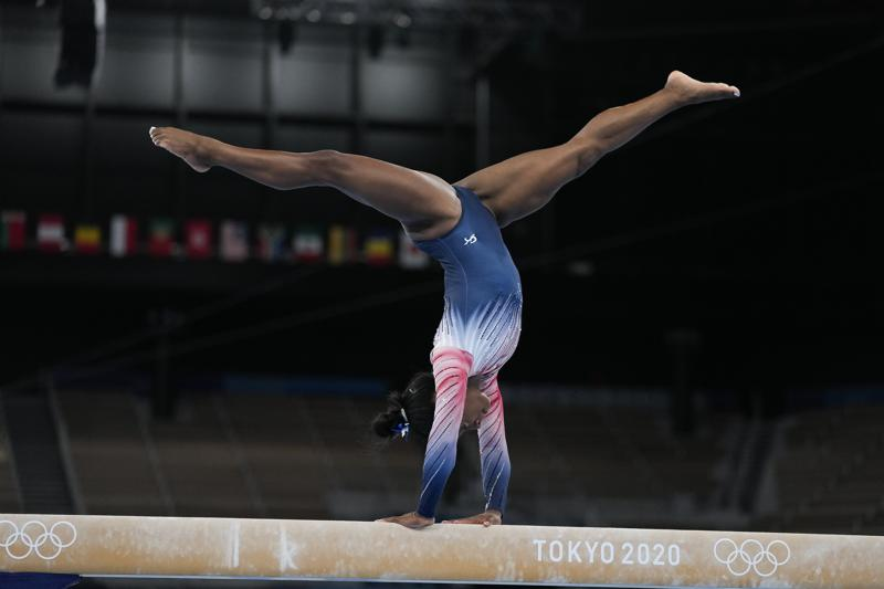 Simone Biles, of the United States, warms up prior to the artistic gymnastics balance beam final at the 2020 Summer Olympics, Tuesday, Aug. 3, 2021, in Tokyo, Japan. (AP Photo/Ashley Landis)