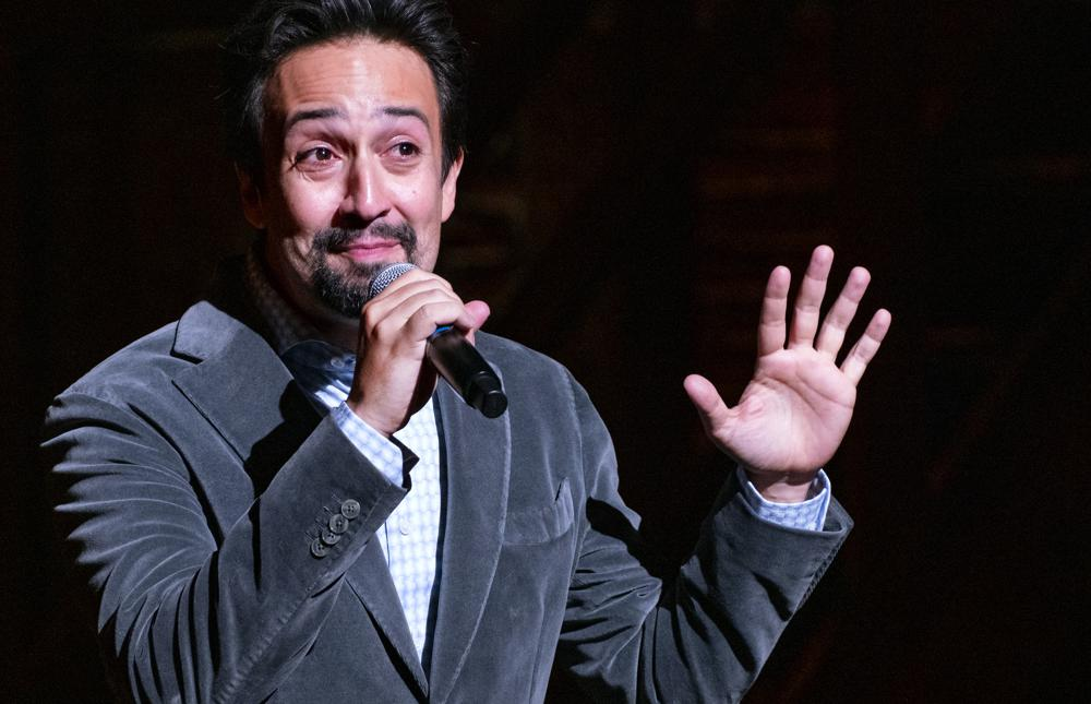 """""""Hamilton!"""" creator Lin-Manuel Miranda gives a curtain speech at the Richard Rodgers Theatre as the show opened Tuesday, Sept. 14, 2021, after being closed in early 2020 due to COVID-19 concerns. (AP Photo/Craig Ruttle)"""