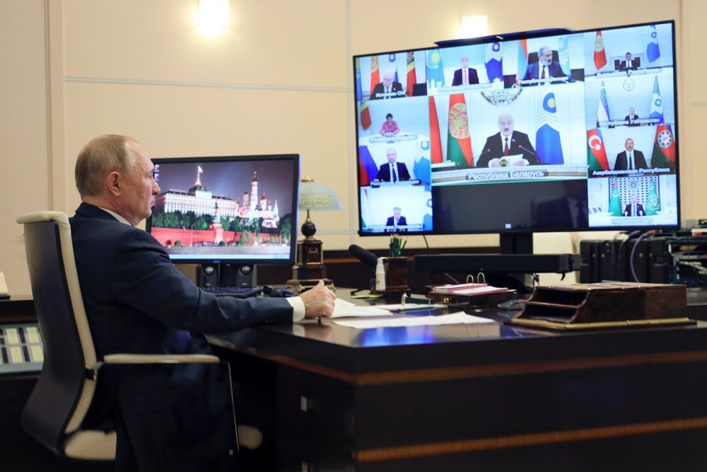 Russian President Vladimir Putin takes part in a virtual Summit of leaders from the Commonwealth of Independent States (CIS) at the Novo-Ogaryovo residence outside Moscow, Russia, Friday, Oct. 15, 2021. (Evgeniy Paulin, Sputnik, Kremlin Pool Photo via AP)