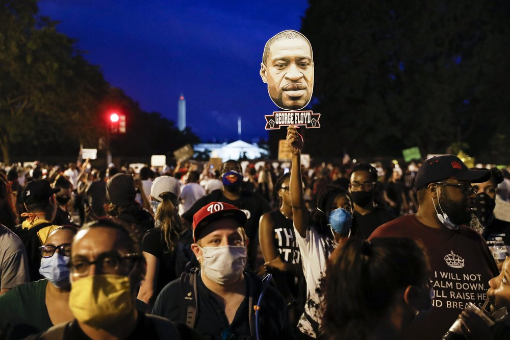 """Violent protests now turn peaceful; the large turnout of white protesters waving signs that said """"Black Lives Matter"""" in San Francisco sends a powerful message"""
