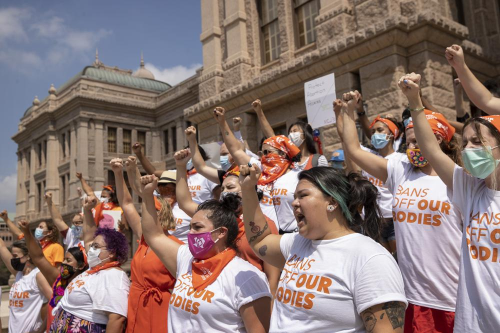 FILE - In this Sept. 1, 2021, file photo, women protest against the six-week abortion ban at the Capitol in Austin, Texas. A federal judge on Wednesday, Oct. 6 ordered Texas to suspend the most restrictive abortion law in the U.S., which since September has banned most abortions in the nation's second-most populous state. (Jay Janner/Austin American-Statesman via AP, File)
