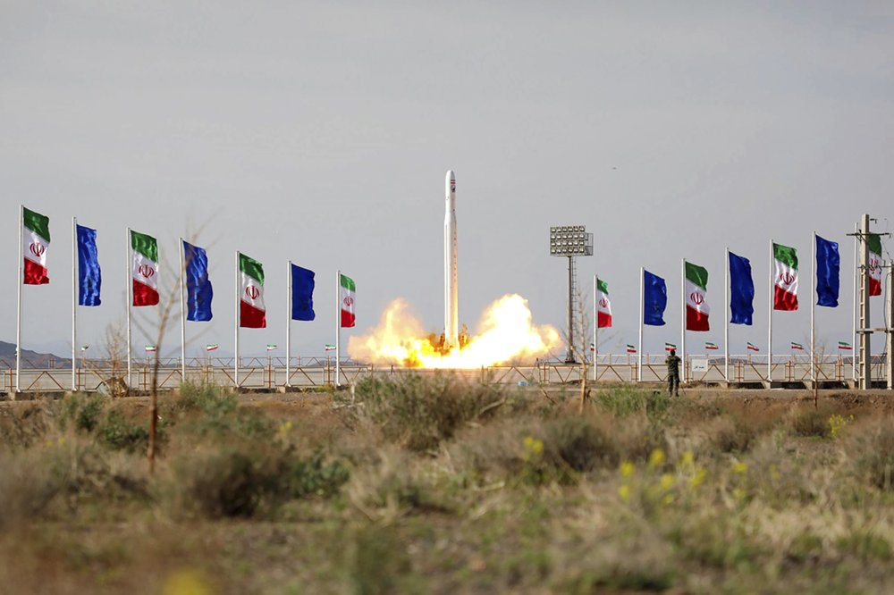 Iran's Revolutionary Guard launches its first satellite into space revealing what experts describe as a secret military space program that could move  its ballistic missile  development forward