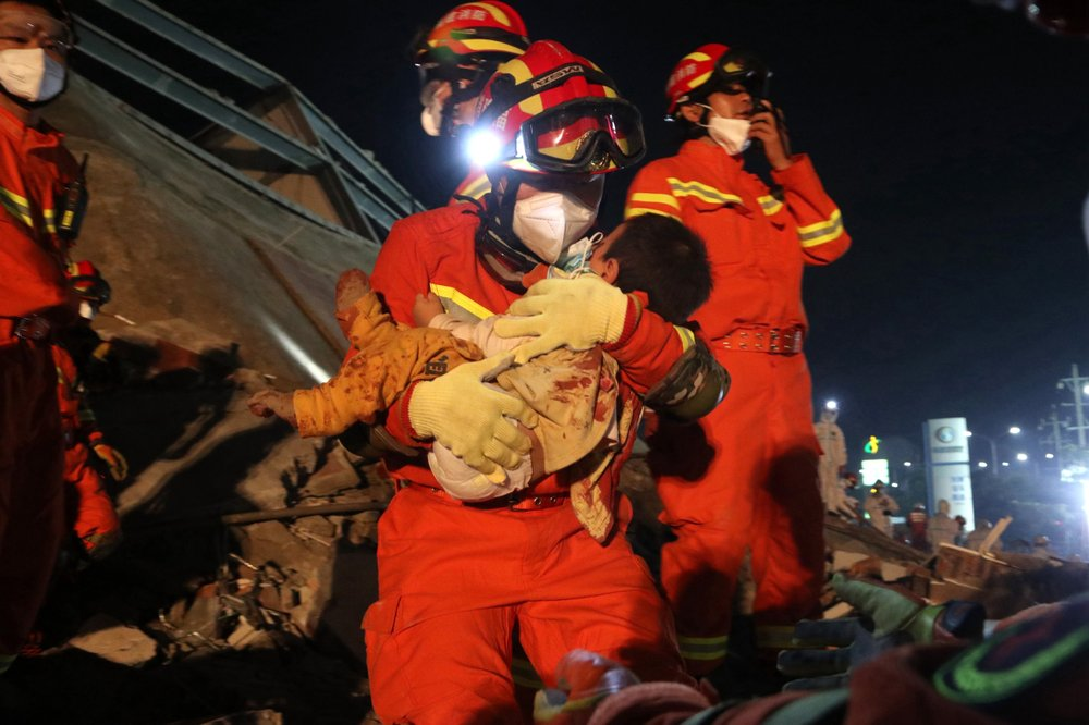 A 10-year-old boy and his mother rescued 52 hours after being trapped in the collapse of a virus quarantine site in southeastern China; 20 people have died