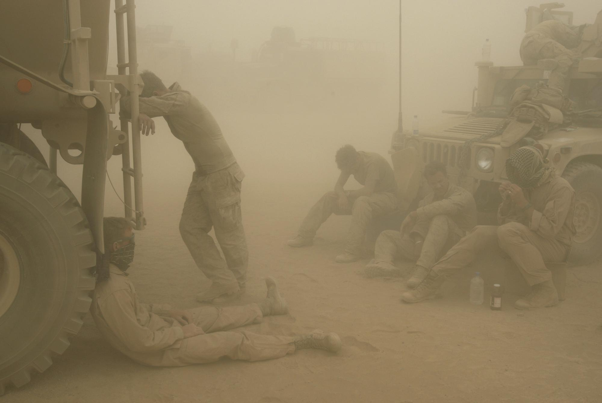 FILE - In this Wednesday, May 7, 2008 file photo, U.S. Marines from the 24th Marine Expeditionary Unit try to take shelter from a sand storm at forward operating base Dwyer in the Helmand province of southern Afghanistan. (AP Photo/David Guttenfelder, File)