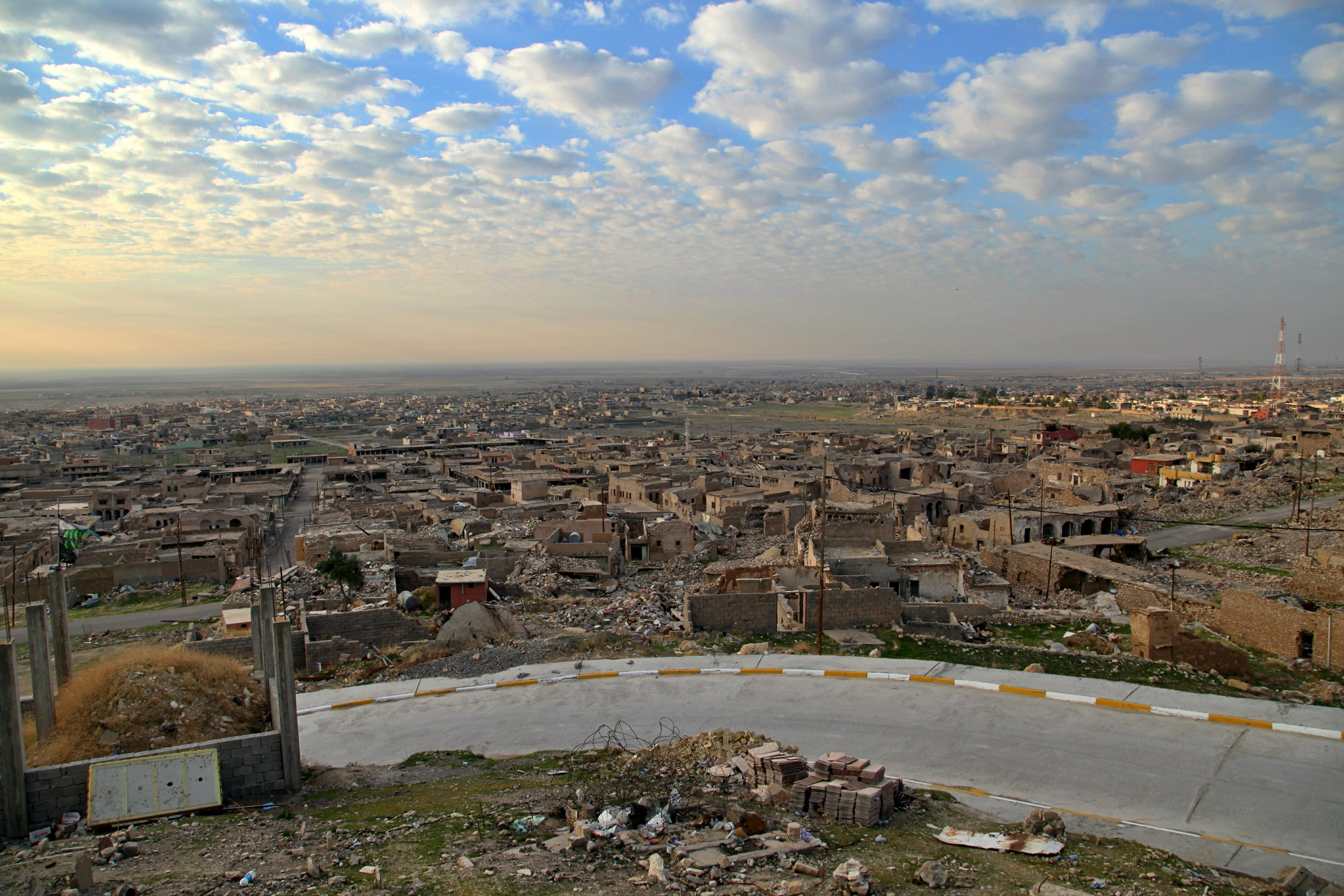 In a city to the north brutalized by IS, Iraq tests its power