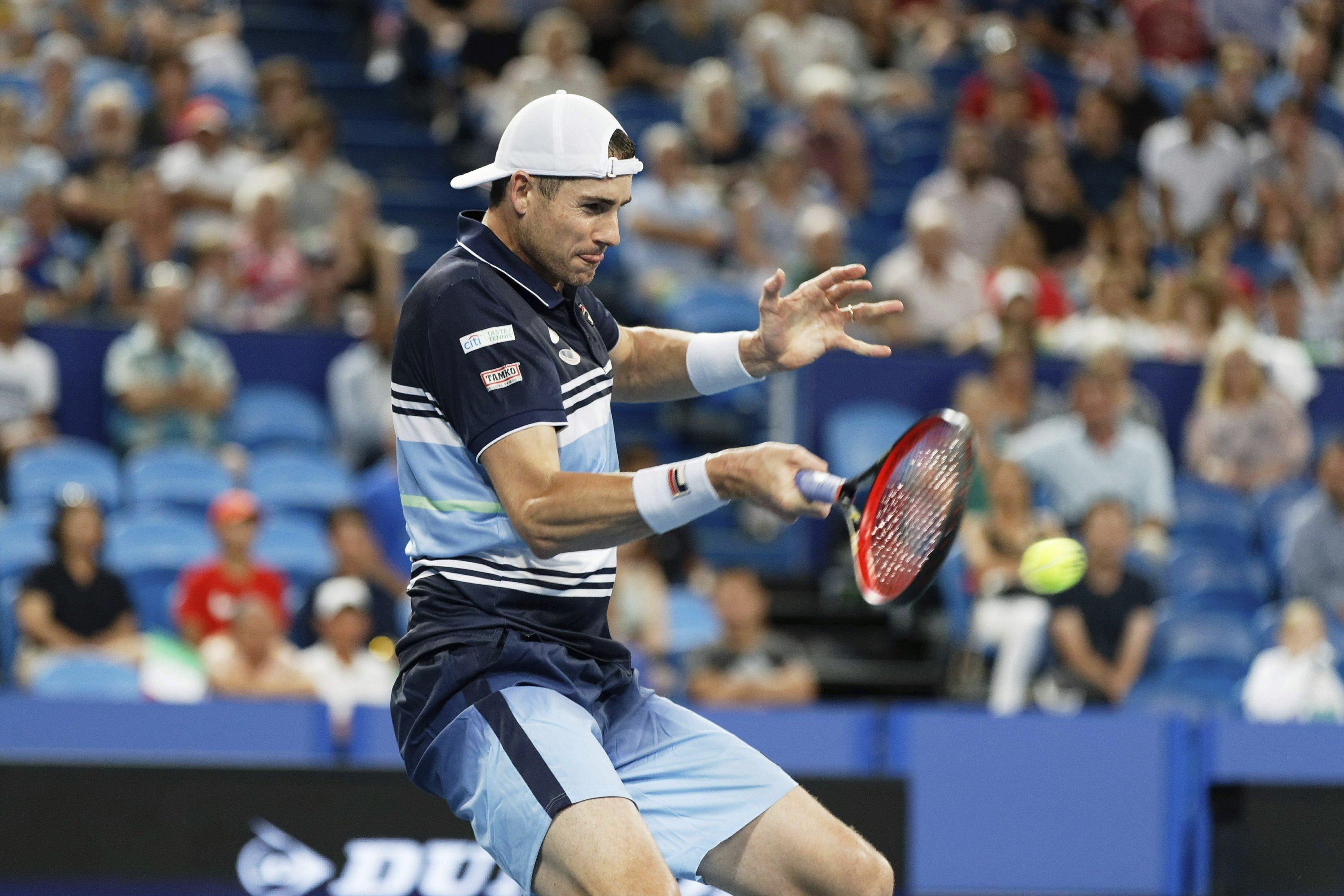 Isner outlasts Sandgren at ASB Classic; top-seed ousted