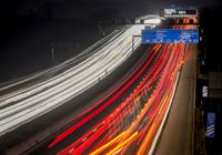 In this long time exposure photo, trucks and cars roll on a highway in Frankfurt, Germany, Tuesday, Oct. 26, 2021. (AP Photo/Michael Probst)