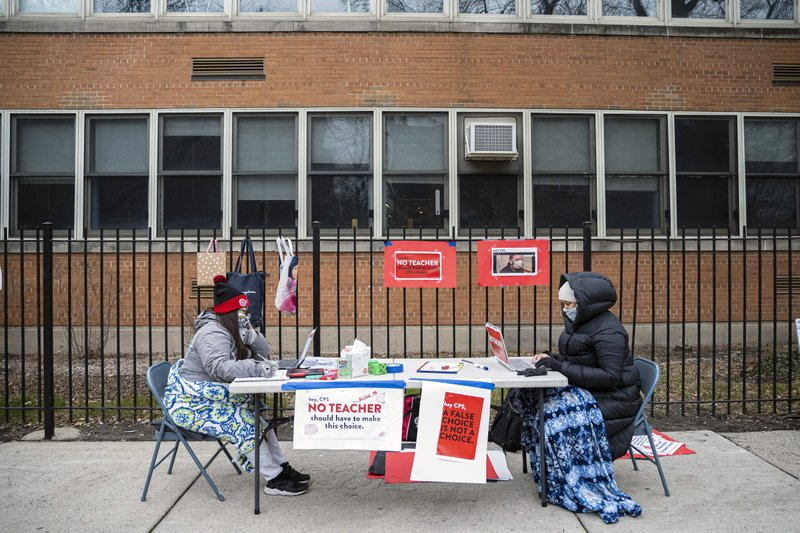 Chicago schools throw out plans for reopening as union fight escalates