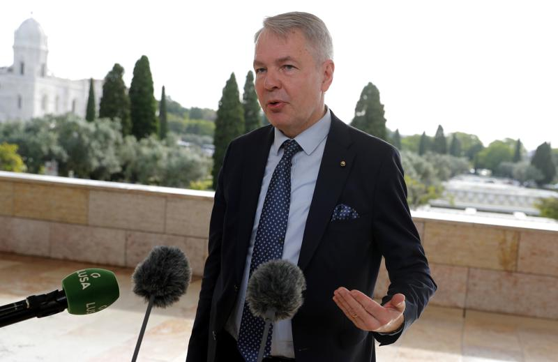 """FILE - In this Thursday, May 27, 2021 file photo, Finland's Foreign Minister Pekka Haavisto speaks with the media in Lisbon. A European Union envoy says Ethiopia's leaders told him in closed-door talks earlier this year that """"they are going to wipe out the Tigrayans for 100 years."""" The envoy, Pekka Haavisto, Finland's foreign minister, says such an aim """"looks for us like ethnic cleansing."""" Haavisto spoke in a question-and-answer session Tuesday, June 15 with a European Parliament committee. (AP Photo/Armando Franca, file)"""