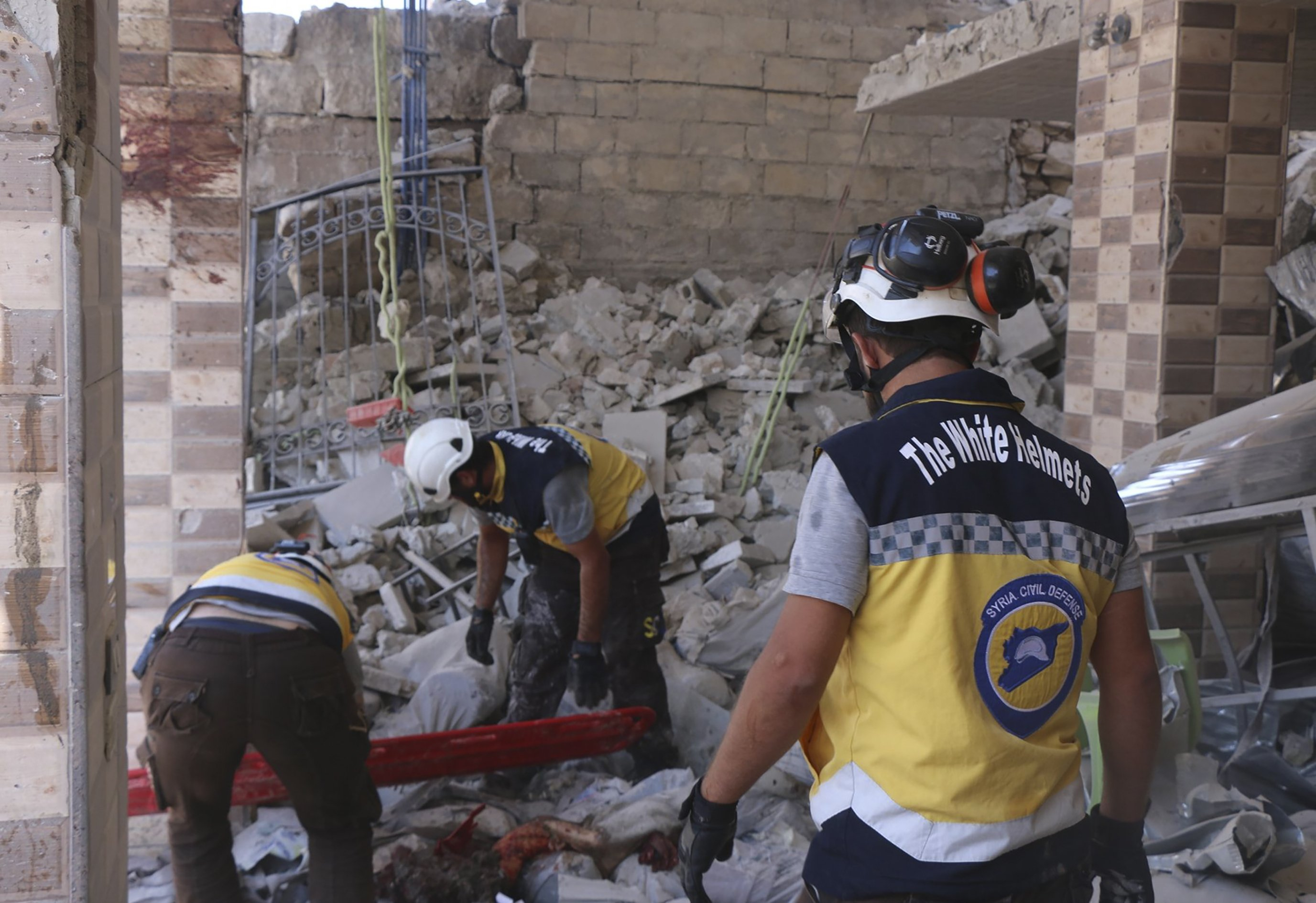 Syrian activists say airstrikes kill 27 in rebel-held town