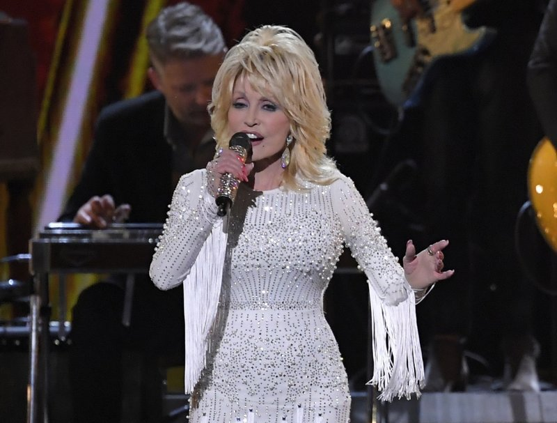 Country singer Dolly Parton adds to list of accomplishments for her contribution to an experimental coronavirus vaccine