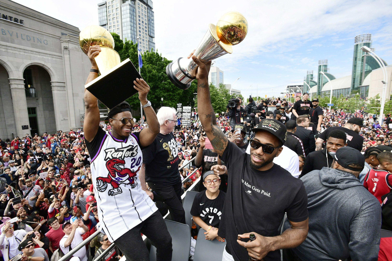 Huge crowds pack downtown Toronto for Raptors parade