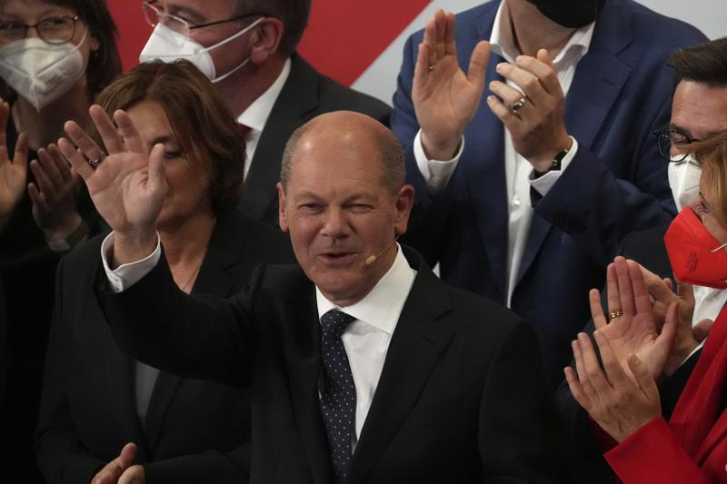 Olaf Scholz, Finance Minister and SPD candidate for Chancellor waves to his supporters after German parliament election at the Social Democratic Party, SPD, headquarters in Berlin, Sunday, Sept. 26, 2021. (AP Photo/Michael Sohn)