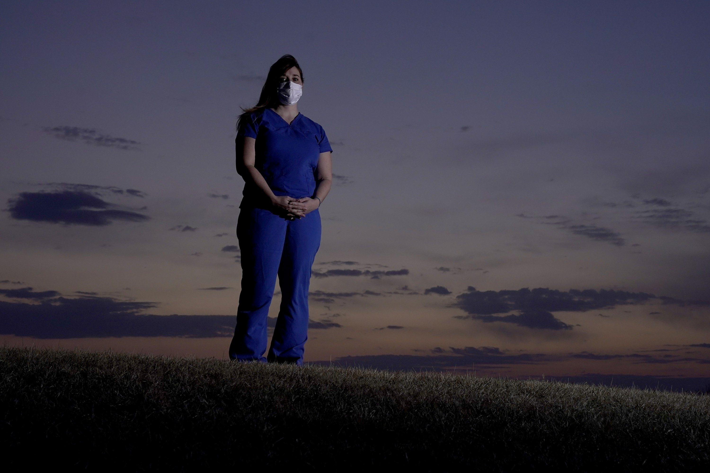 Nurses fight conspiracy theories along with coronavirus - The Associated Press