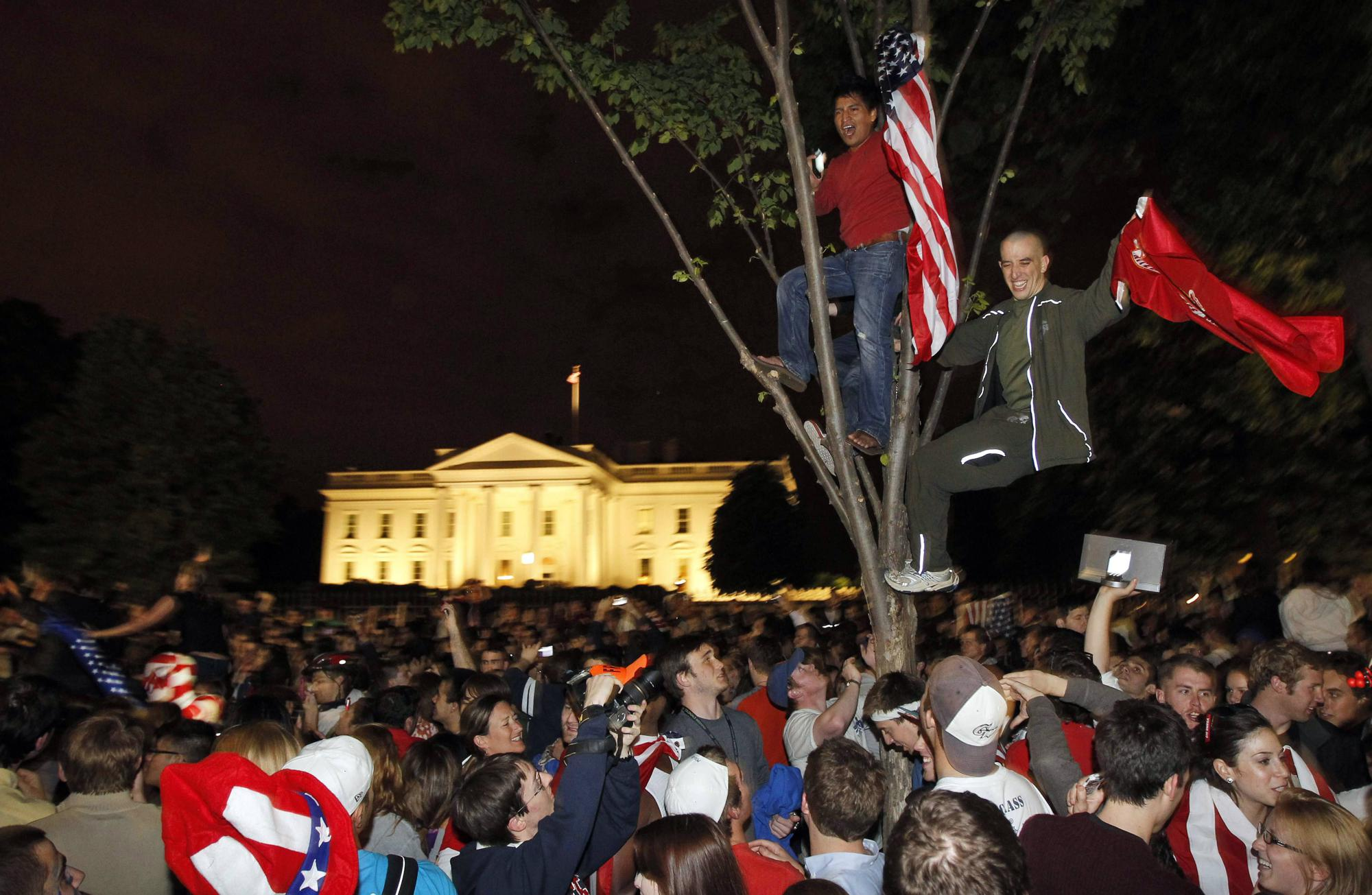 FILE - In this Monday, May 2, 2011 file photo, crowds climb trees and celebrate in Lafayette Park in front of the White House in Washington after President Barack Obama announced that Osama bin Laden had been killed. (AP Photo/Charles Dharapak, File)