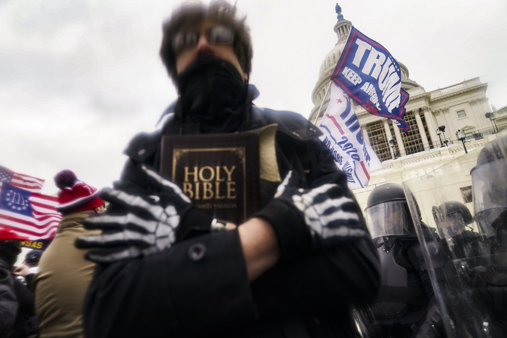 Christian faith on display at Capitol riot seen as misuse of their faith to justify a violent attack