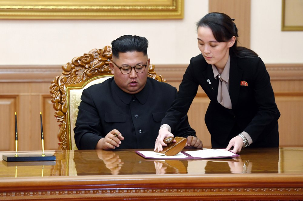 FILE - In this Sept. 19, 2018, file photo, Kim Yo Jong, right, helps her brother North Korean leader Kim Jong Un sign a joint statement following the summit with South Korean President Moon Jae-in at the Paekhwawon State Guesthouse in Pyongyang, North Korea. North Korea has threatened to end an inter-Korean military agreement reached in 2018 to reduce tensions if the South fails to prevent activists from flying anti-Pyongyang leaflets over the border. The powerful sister of Kim Yo Jong also said Thursday, June 4, 20202, the North could permanently shut a liaison office with the South and an inter-Korean factory park in the border town of Kaesong, which have been major symbols of reconciliation between the rivals.  (Pyongyang Press Corps Pool via AP, File)