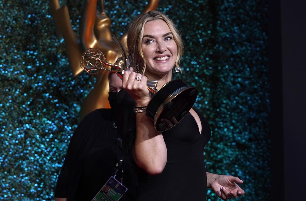 """Kate Winslet, winner of the award for outstanding lead actress in a limited or anthology series or movie for """"Mare of Easttown"""" poses at the 73rd Primetime Emmy Awards on Sunday, Sept. 19, 2021, at L.A. Live in Los Angeles. (AP Photo/Chris Pizzello)"""