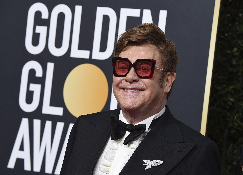 Elton John, sick with pneumonia, cuts New Zealand show short thumbnail
