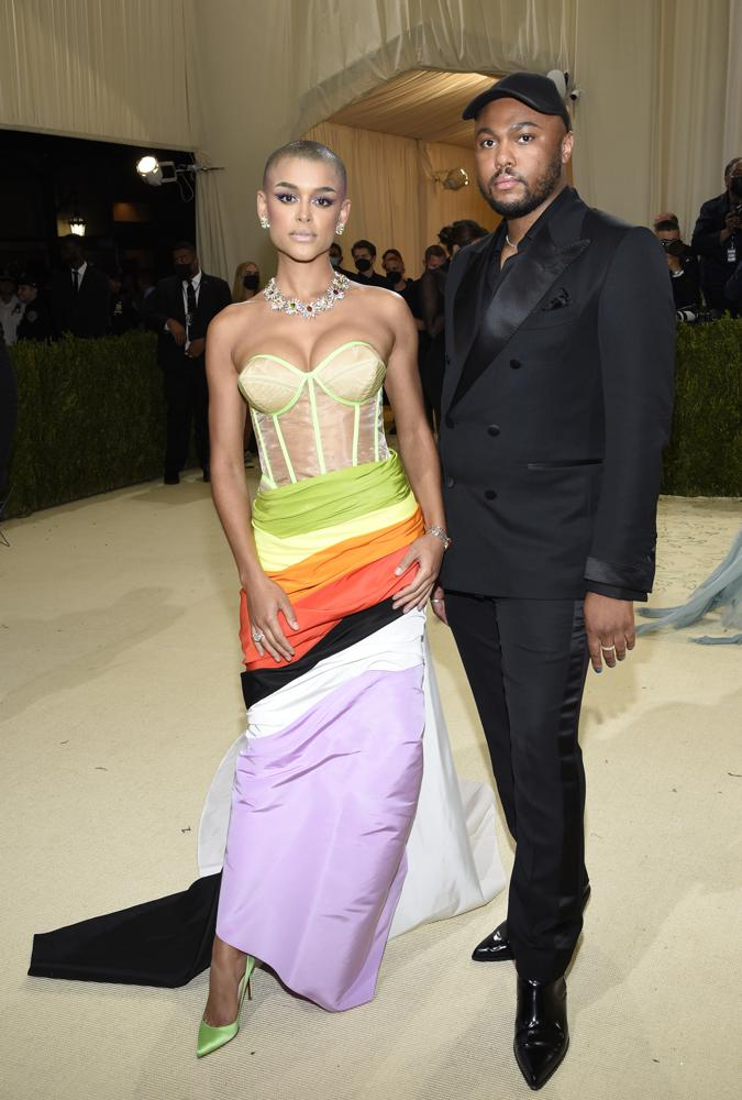 """Jordan Alexander, left, and Christopher John Rogers attend The Metropolitan Museum of Art's Costume Institute benefit gala celebrating the opening of the """"In America: A Lexicon of Fashion"""" exhibition on Monday, Sept. 13, 2021, in New York. (Photo by Evan Agostini/Invision/AP)"""