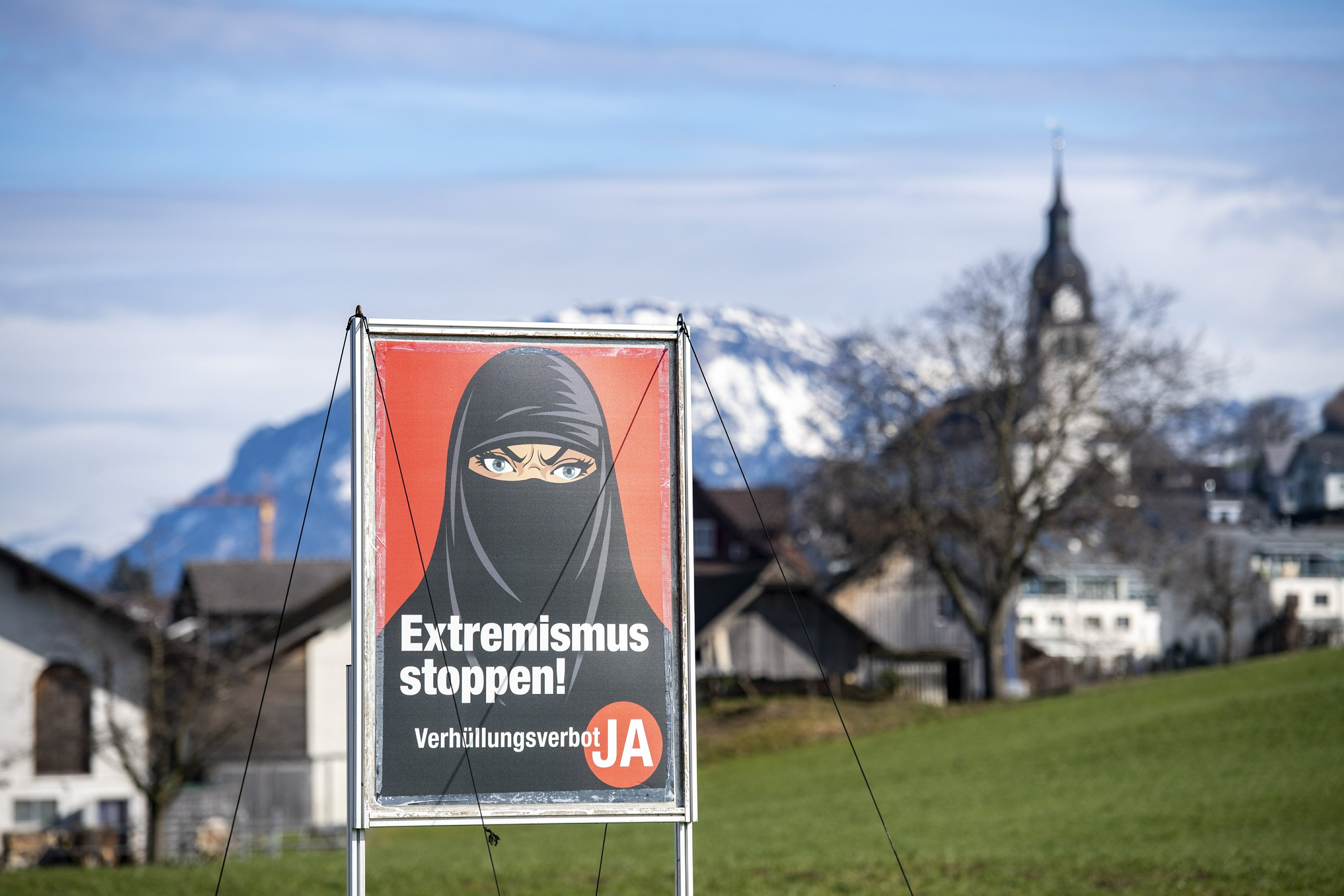 Swiss vote on proposal to ban face coverings in public - The Associated Press