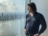 Robinhood CEO Vlad Tenev poses for a picture during an interview about the company that introduced a new generation of investors into the stock market and forced the industry to stop charging fees for trading, Wednesday, July 28, 2021, in New York. Shares of Robinhood Markets are set to begin trading on the Nasdaq for the first time Thursday. (AP Photo/David R. Martin)