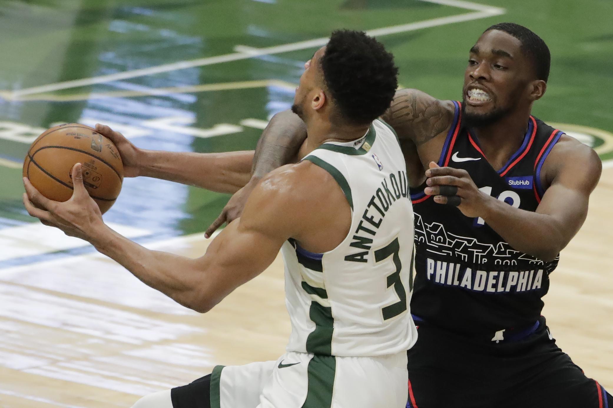 Bucks start out strong, defeat 76ers 124-117