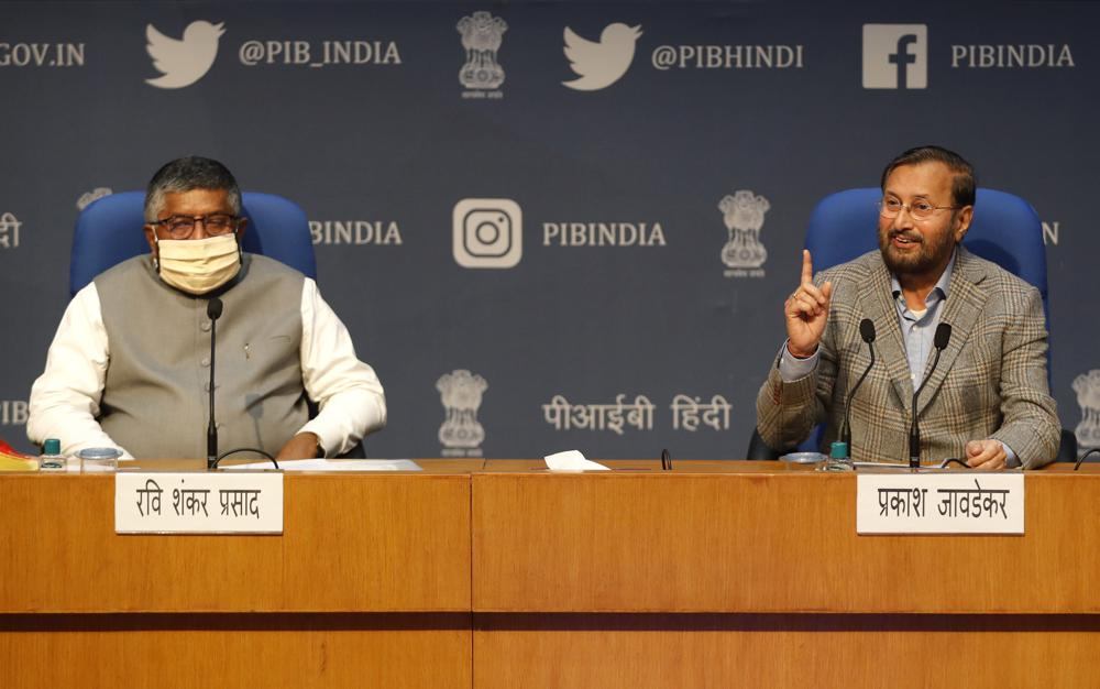In this Thursday, Feb. 25, 2021, file photo, India's Information Technology Minister Ravi Shankar Prasad, left, and Information and Broadcasting Minister Prakash Javadekar address a press conference announcing new regulations for social media companies and digital streaming websites in New Delhi, India. It began in February with a tweet by pop star Rihanna that sparked widespread condemnation of Indian Prime Minister Narendra Modi's handling of massive farmer protests near the capital, souring an already troubled relationship between the government and Twitter.