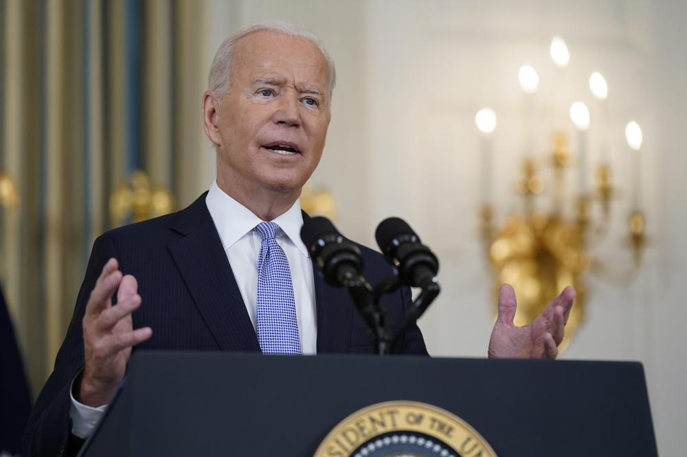 """In this Sept. 24, 2021 photo, President Joe Biden speaks about the COVID-19 response and vaccinations in the State Dining Room of the White House in Washington. President Joe Biden's plan for a massive expansion of social programs is being framed by supporters as such a high-stakes endeavor that it's """"too big to fail."""" It also may be too big to describe.  A series of crises, from Afghanistan to COVID-19, along with the convoluted legislative process have hampered the White House's ability to promote the $3.5 trillion package or even say definitively what's in it. The price tag is sure to shrink and it's possible that components could change. (AP Photo/Patrick Semansky)"""