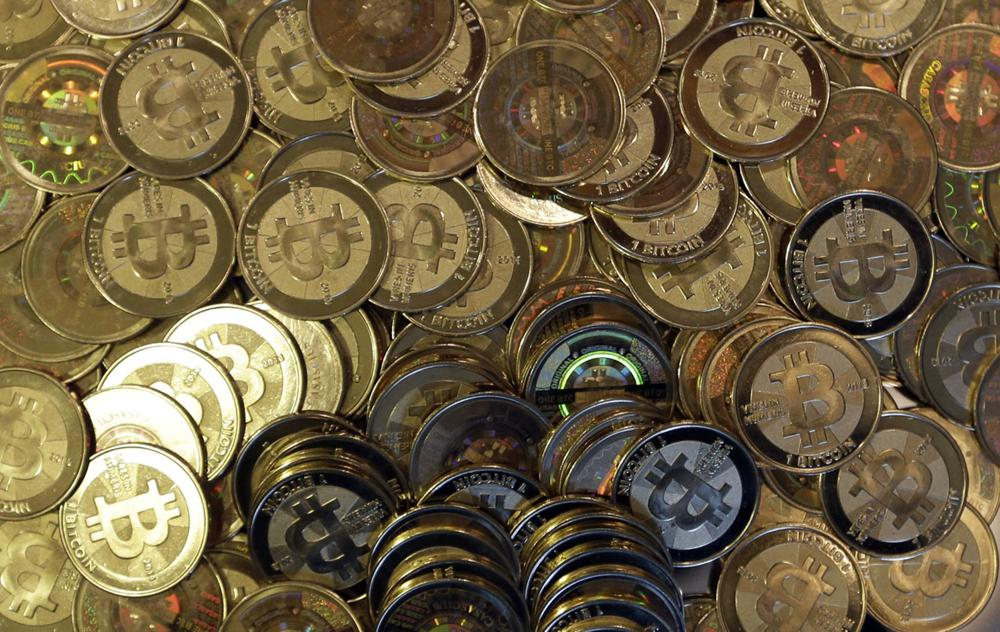 FILE - This April 3, 2013, file photo shows bitcoin tokens in Sandy, Utah. The Cuban government said Thursday, August 26, 2021, that it will start recognizing cryptocurrencies like Bitcoin as payment. (AP Photo/Rick Bowmer, File)