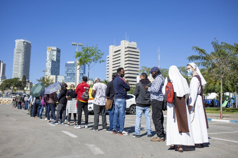 Foreign workers, asylum seekers in Tel Aviv receive COVID-19 shots