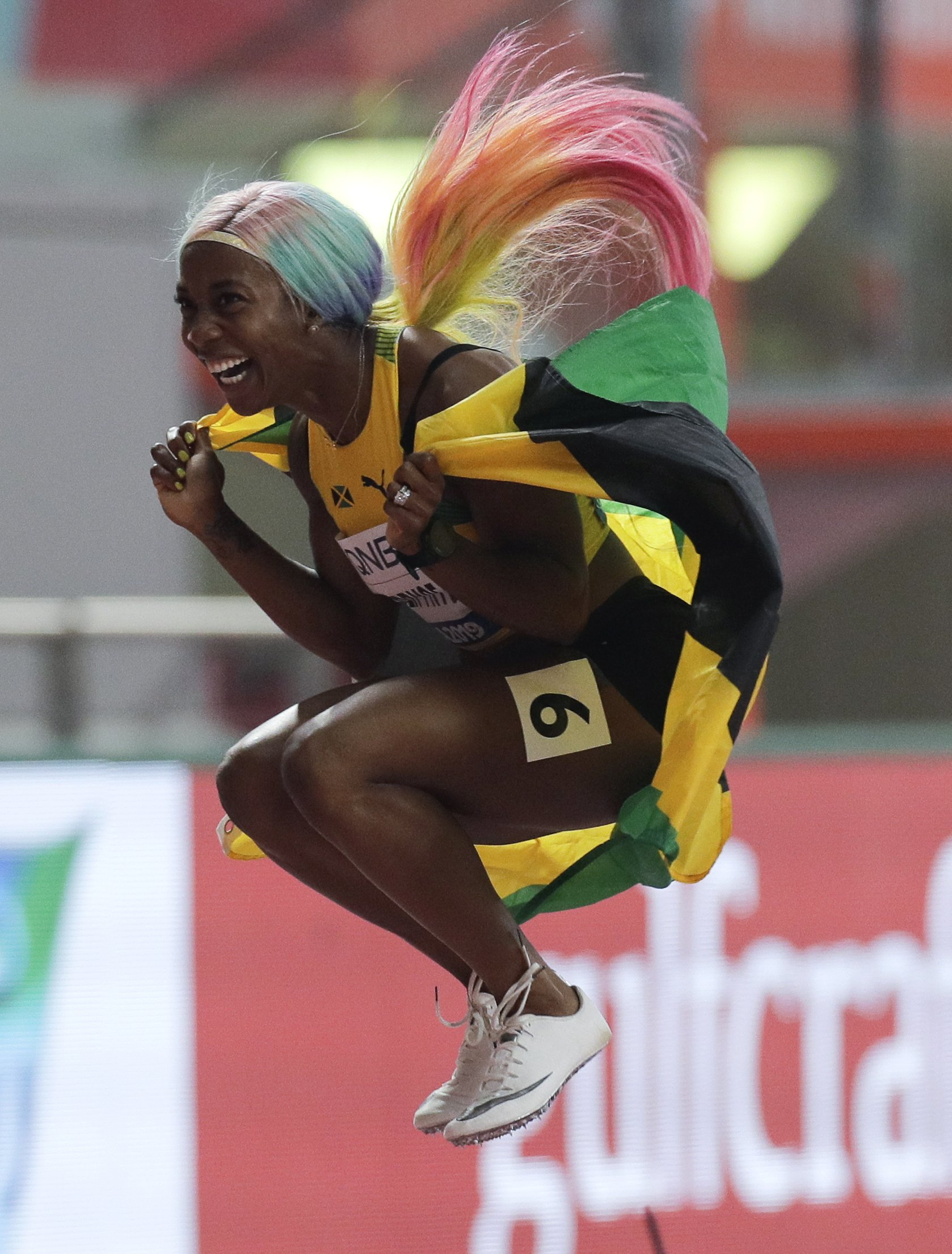The Latest: Fraser-Pryce wins fourth world 100 gold