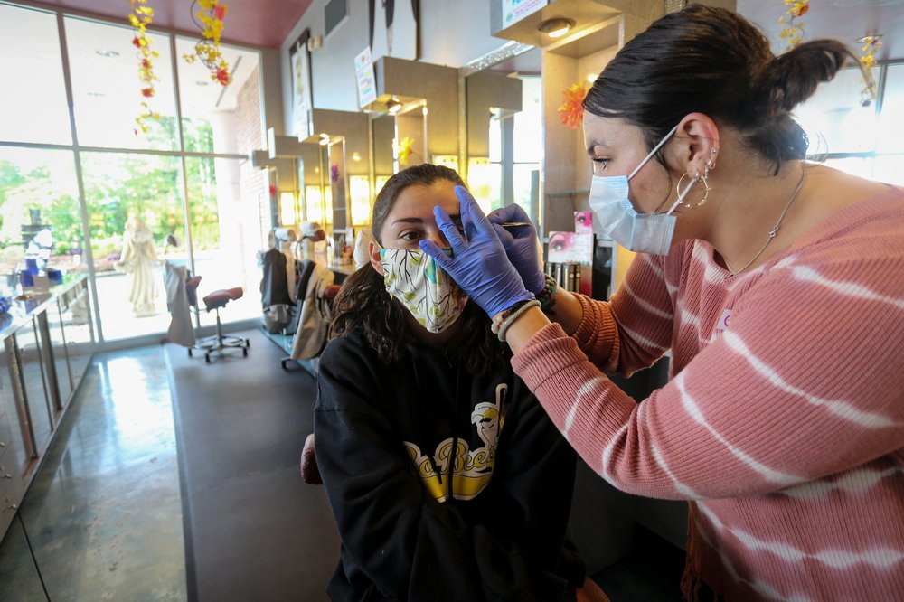 After a month-long shutdown, amid experts' warnings of a potential new surge in coronavirus infections, some businesses are back in business in Georgia