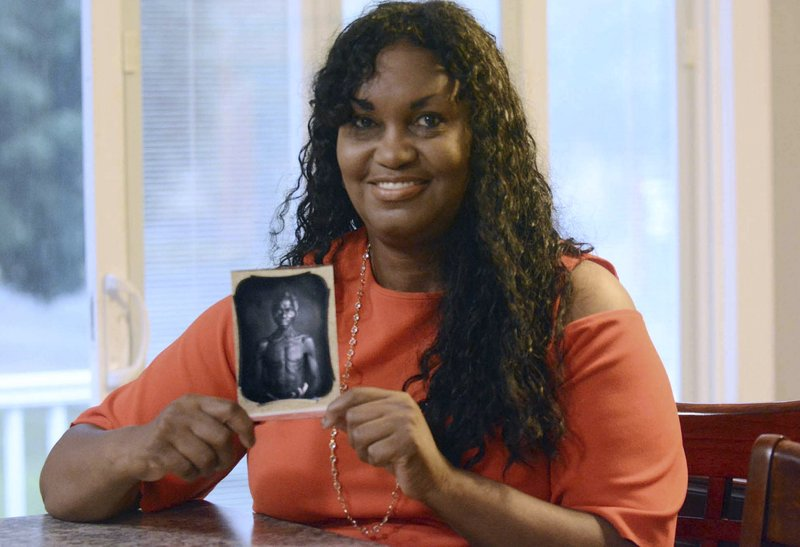 Judge dismisses lawsuit from Connecticut woman saying Harvard University illegally has photos of her enslaved ancestors, refuse to turn them over