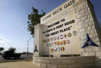 FILE - In this July 9, 2013, file photo, traffic flows through the main gate past a welcome sign in Fort Hood, Texas. A new study finds that female soldiers at Army bases in Texas, Colorado, Kansas and Kentucky face a greater risk of sexual assault and harassment than those at other posts, accounting for more than a third of all active duty Army women sexually assaulted in 2018. The study by RAND Corporation was released Friday.  (AP Photo/Tony Gutierrez, File)