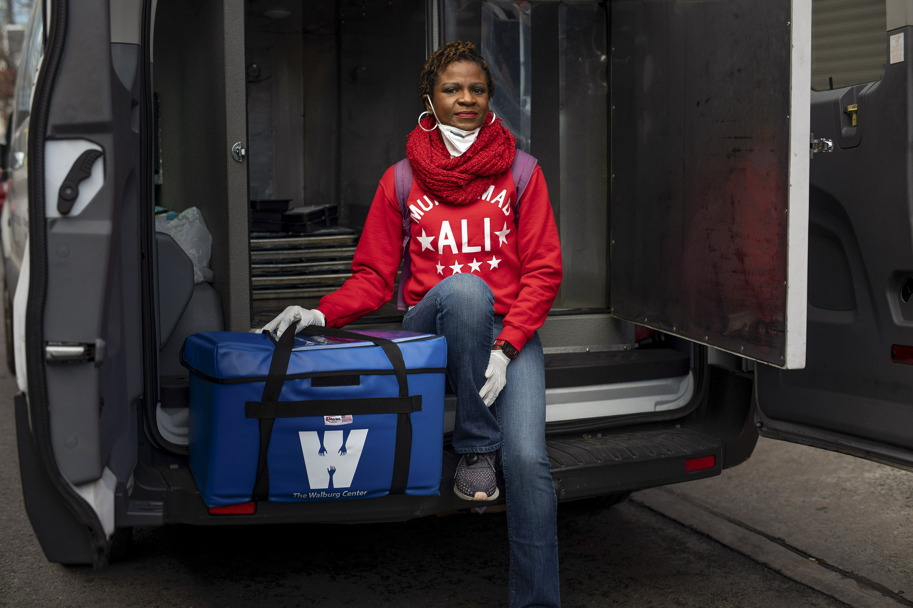 As elderly are left alone, a race to deliver food they need